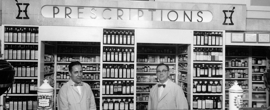Harold Kester and John Lawson working behind the pharmacy counter at Oswald's in the 1940s.