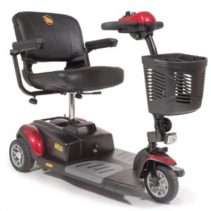 """Golden Buzzaround XL Scooter, 3-wheel model. Black with grey accents and red shroud plates. 18"""" faux-leather seat. Basket on the front of the tiller."""