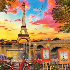 Springbok Puzzles' default image--a very colorful picture of two painting easels portraying the Eiffel Tower, looking across the river at the actual Eiffel Tower. The sky is every color of the rainbow. A bike leans against a stone fence in the foreground.