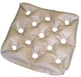 EHOB waffle cushion. A tan waffle cushion used for pressure and bed sores.