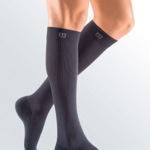 Mediven Active brand default image. A leg model with a pair of dark grey, knee-high compression socks.