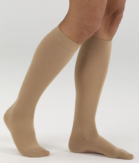 5e0bad0fcca716 Mediven Comfort line image. A leg model with a pair of beige, knee-
