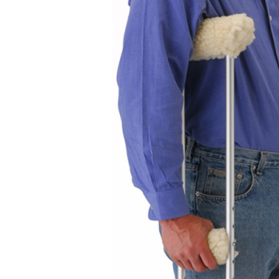 nova crutch cover cushions. A fleece crutch topper, shown being used by a model.