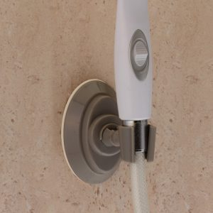 Nova suction cup shower head holder shower aid. Grey suction cup with an attachment to hold a showerhead (pictured in white).