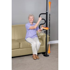 Stander Security Pole, curved handle. An older woman grabs onto the curved part of the black security pole to get off of her couch.