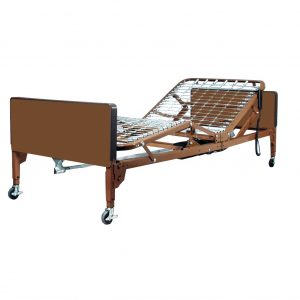 "The Probasics Full Electric Hospital Bed Rental, shown in whole. The bed is lowered to it's lowest position, while the mattress ""spring board"" is in the up position."