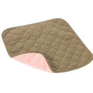 Quicksorb Pad for Incontinence. A tan, absorbent pad.