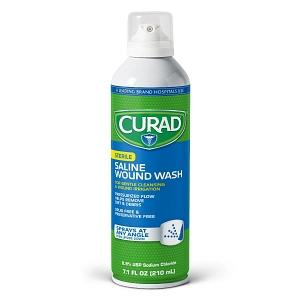 Curad Saline Wound Wash. Green aerosol bottle with a clear cap.