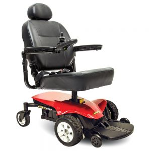 pride jazzy elite es-1 power chair. Black on black with a few red accents. 4-wheel,s one hand control on right armrest.
