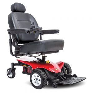 jazzy elite portable power chair. Black on black with a few red accents. 4-wheel,s one hand control on right armrest.