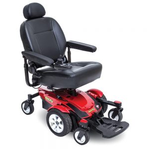 Jazzy Select 6 Power chair. Black on black with a few red accents. 6-wheel,s one hand control on right armrest.