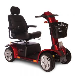 pride pursuit 4 wheel mobility scooter full size outdoor model. Red base, drive shaft and wheel covers, the tires have grey hubcaps, everything else is black.