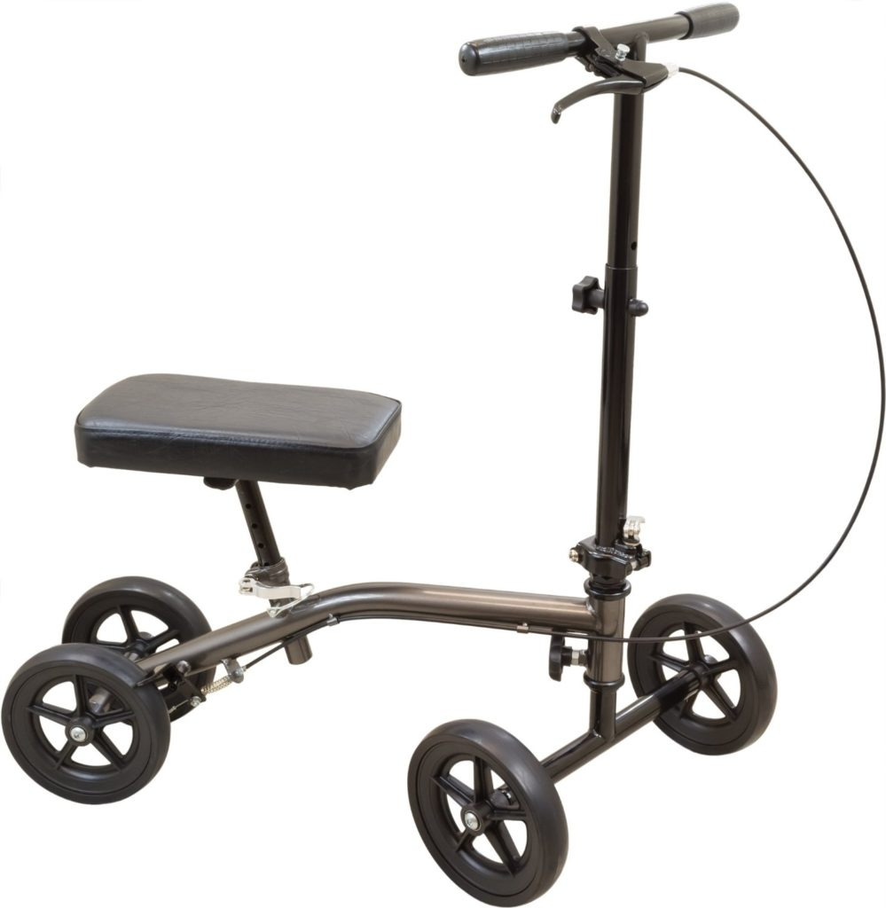 Carex knee scooter. Grey frame with black parts and wheels. On a white background.