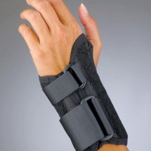 "Pro Lite Low Profile 6"" Wrist Splint. A low profile carpal tunnel brace is worn by a model. The brace has 2 straps, and is all black. Stretches from mid-hand to just below the wrist."