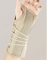 Soft Fit Suede Finish Wrist Brace. A beige carpal tunnel brace worn by a model. The adjustable strap on this brace is 4 elastic ropes instead of one velcro band, allowing for a comfortable universal fit.