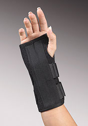 "FLA Uni Fit 8"" Wrist Splint brace. A black carpal tunnel brace with 2 adjustable straps worn by a model."