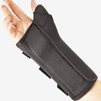 FLA Prolite Wrist Splint w/Abducted Thumb brace. A black carpal tunnel brace that also has thumb support. Worn by a model.