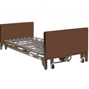 "The ProBasics Full Electric Hospital Bed shown in it's lowest position (only 9"" from the ground). The bed frame, header and footer are all painted light brown."