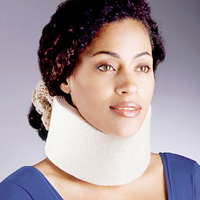 "FLA Universal Cervical Collar worn by a model. The collar is white and about 3"" in height, allowing the model to rest her chin on it."
