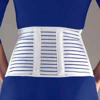 FLA Cool-Lightweight Lumbar Sacral Support. The picture shows a female model in a blue shirt wearing the support. The support is blue, streaked with white and goes from just above the rear end to the mid-back.