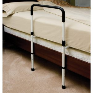 Essentials Endurance Bed Rail with Floor Support shown assembled and placed under a mattress. The rail is white with black accents and it's feet rest on the floor.