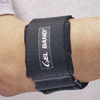 "FLA Gelband Arm Band. A black brace with the words ""GEL*BAND"" printed next to a stylized logo in the middle. Worn by a model just above the elbow."
