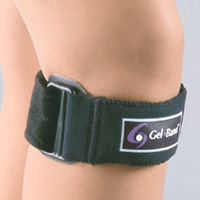 FLA Gelband Patella Strap on a model's knee. The band is black with a logo in the center, and straps around just below the knee, like a bracelet for the knee.