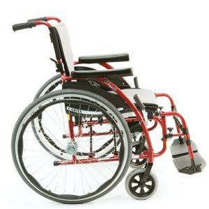 Karman S-Ergo 115 Ultra Lightweight Wheelchair. Side view of a red wheelchair with spoked bike wheels. A black seat with a large gray cushion is seen as well.