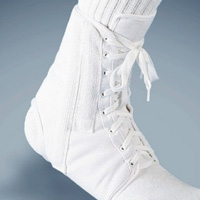 FLA Canvas Lace-Up Ankle Brace The brace is all white, with athletic laces. Stretches from mid-foot to just above the ankle.