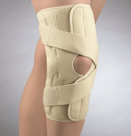 FLA OA/Arthritis Knee Brace. Open patella, The brace is beige and stretches from 4 inches below the knee to the mid-thigh. 2 adjustment straps are just above and below the knee--they crisscross in the middle for additional support.