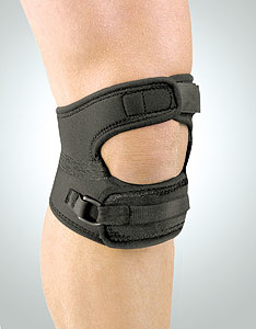 FLA Safe-T-Sport Patella Support. The brace is black and has two inch long straps, on going over the model's knee and one under. The patella is open and the straps are adjustable.