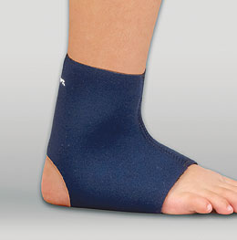 FLA Pediatric Safe-T-Sport Neoprene Ankle Support on a model's foot. Blue, open-heel design, the brace goes from the middle of the foot to just above the ankle.