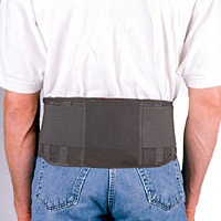 "FLA Safe-T-Belt Working Back Support. A male model is wearing a white t shirt and blue jeans, with the safe t belt being worn. The belt is all black and is around 6"" high, going from the top of the models buttocks to the upper lumbar region."