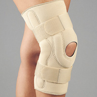 FLA Safe-T-Sport Neoprene Stabilizing Knee Brace with Composite Hinges. Open patella, The brace is beige and stretches from 4 inches below the knee to the mid-thigh. 2 adjustment straps are just above and below the knee.