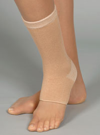 FLA Therall Joint Warming Ankle Support. A foot model wears the ankle support which stretches from the middle of the foot to just above the ankle.