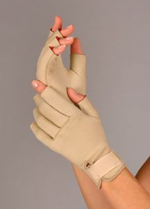 FLA Therall Arthritis Gloves. A Hand model wears the arthritis gloves on both hands. The gloves are tan, fingerless gloves with a strap at the wrist for size adjustments.
