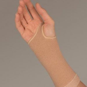 "FLA Therall Joint Warming Wrist Support. A hand model wears the tan brace. The brace stretches from 4"" below the write to mid-hand, with an opening for the thumb."