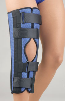 FLA Breathable Universal Tri-Panel Foam Knee Immobilizer over a model's knee. The brace casing is blue with black reinforcements and hinges. Open-patella design.