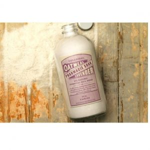 Pharmacie Soaks by Jane Inc. Oatmeal lavender scented. The glass bottle is 16oz, with a light-pink hue. The label is in the style of old pharmacy bottles from the early 1900s.