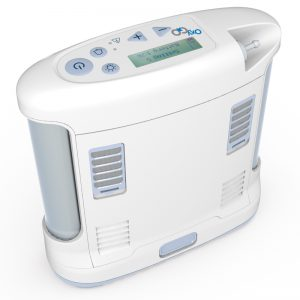 OxyGo Portable Oxygen Concentrator image. The oxygo is shown up close on a white background. The unit is not plugged in.