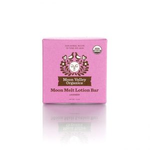 Moon Valley Organics Moon Melt Lotion Bar on a white background. Pink label.