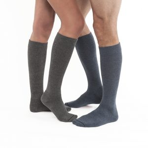 Jobst activewear compression socks being worn by two leg models. Both styles are knee high and grey in color. The left set of legs belong to a woman and the the right to a man.