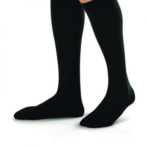 Jobst For Men Compression Socks in black on a leg model. Knee high style in black.