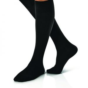 Jobst For Men Compression Socks in black on a leg model. Knee high casual business style in black.