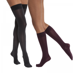 Jobst opaque compression stockings being worn by two leg models. The left set of legs belong to a woman and are thigh-high black. The legs on the right belong to a man and are in the knee-high style in black.