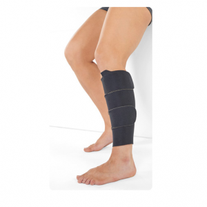Juzo compression wrap being worn by a male leg model. The wrap is securely wrapped around the man's left calf.