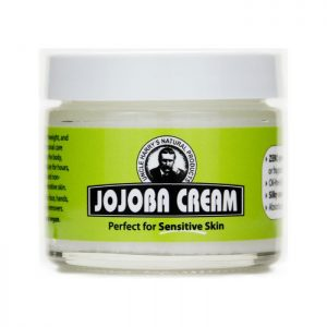 Uncle Harry's Jojoba Cream product image. 2oz size in a white jar with a green, black and white label.