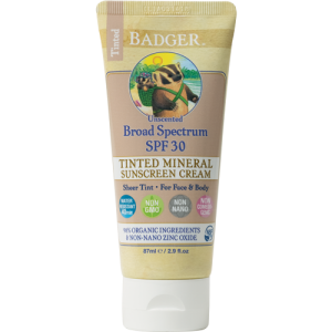 Badger Tinted Sunscreen SPF 30 2.9oz tube. Cream colored tube with beige accents, product information and the badger logo.