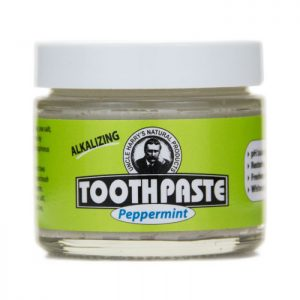 Uncle Harry's Peppermint Toothpaste product image. 3oz glass jar with a white top and a green, black and white label. Peppermint is printed in a blue font.