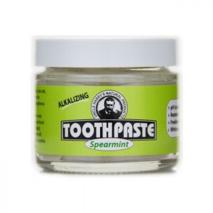 Uncle Harry's Spearmint Toothpaste product image. 3oz glass jar with a white lid and a green, black and white label. Spearmint is printed in a green font.